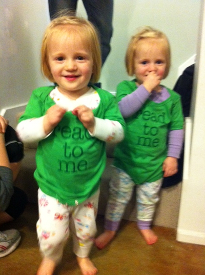 Twins wearing read to me onesies.